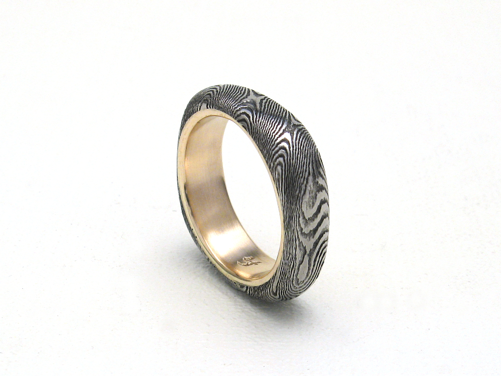 Squared damascus ring lined in gold